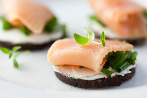 photo: Canapés with Westphalian pumpernickel and salmon. http://de.fotolia.com/id/34575206 © B. and E. Dudzinscy / fotolia.com