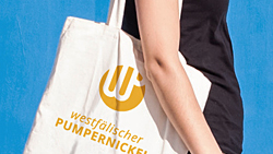 Foto: Einkaufstasche mit Logo Westfälischer Pumpernickel. http://de.fotolia.com/id/71522577 © drimafilm / fotolia.com; composition: Art des Hauses